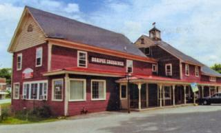 Photo of wooden 2-story building