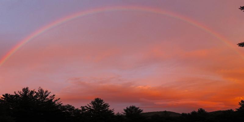 rainbow on sunset sky