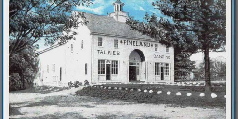 Pineland - building and large yard in front