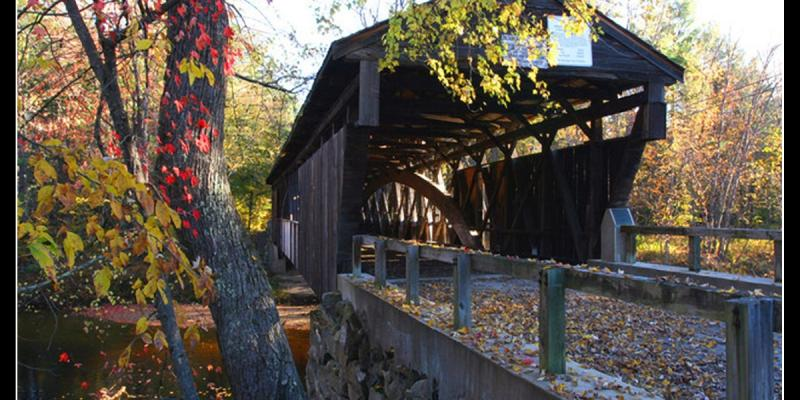 Left-side guardrail and covered Bridge - looking down its length - Whittier Covered Bridge in West Ossipee